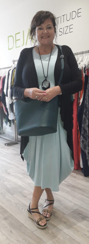 wearing black: handbag and cardigan